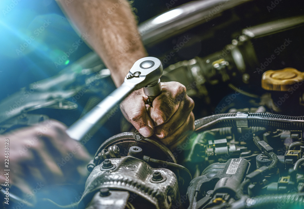 Fototapety, obrazy: Auto mechanic working on car engine in mechanics garage. Repair service. authentic close-up shot
