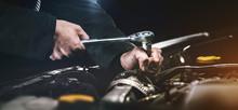 Auto Mechanic Working On Car Engine In Mechanics Garage. Repair Service. Authentic Close-up Shot
