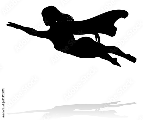 Photo  A woman caped superhero flying in silhouette