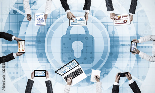 Fotografía  Top view of businesspeople sitting at table and using gadgets