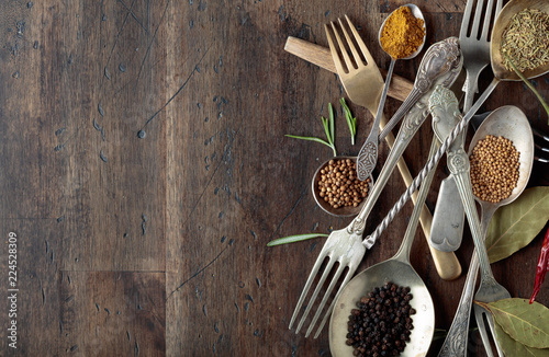 Various herbs and spices on wooden table.