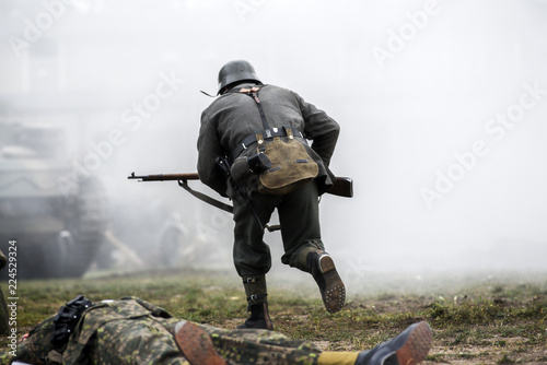 Fototapeta Historical reenactment of soldiers during the Second World War, view from the ba