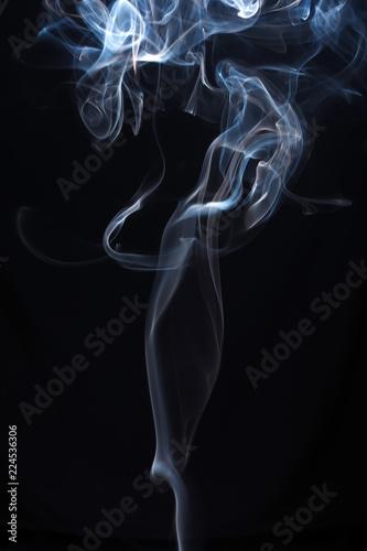 Fotobehang Rook Blue and white smoke on black background