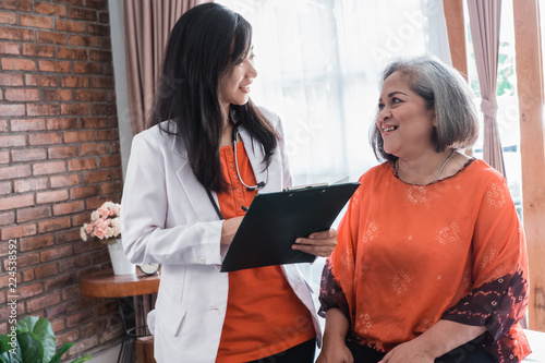 mature woman visitting doctor Canvas Print