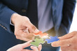 Closeup hand of businessman connecting jigsaw puzzle with teamwork, Business solutions, success and strategy concept