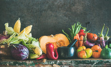 Fall Vegetarian Food Ingredients. Assortment Of Various Autumn Vegetables For Healthy Cooking Over Rustic Cupboard, Dark Wall Background, Copy Space, Selective Focus. Local Market Organic Produce