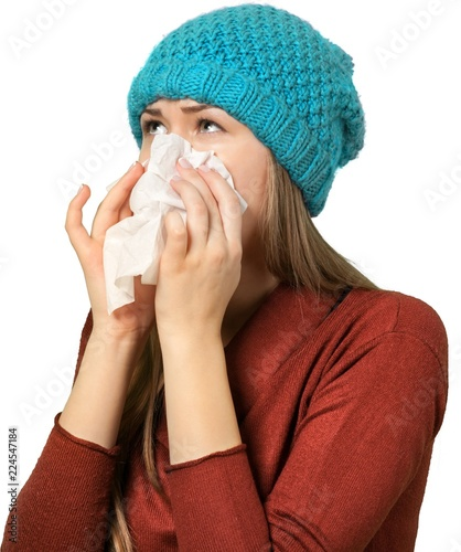 Fotografering young woman suffering from a cold