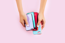 Hands Holding Colorful Smartphone Cases