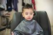 Cute baby boy toddler - cutting hair.