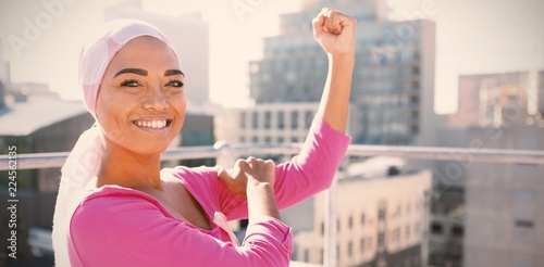 Strong woman in city with breast cancer awareness Canvas Print