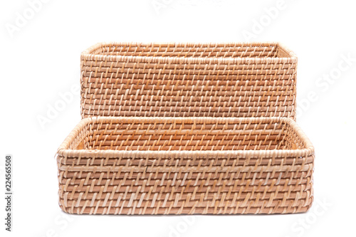 Fotografie, Obraz  Handwoven in Indonesia exotic and functional rattan storage basket isolated on white background