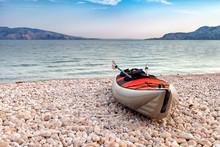 Empty Kayak On Beach Over Sea ...