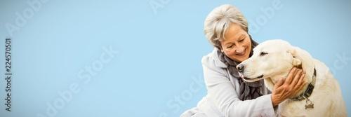 Photo Composite image of senior woman holding a dog