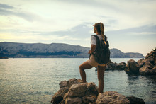 Traveller Woman With Backpack Looking At Sea Bay