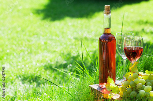 Rose wine bottle and grapes