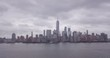 Drone of NY City skyline on horizon overcast
