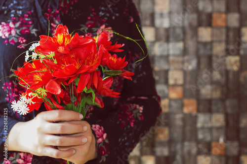 Fotografie, Obraz  Woman holding beautiful bouquet of flowers