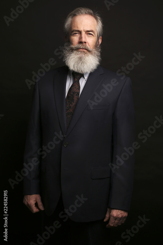 Foto op Aluminium Aap mature male model wearing suit with grey hairstyle and beard