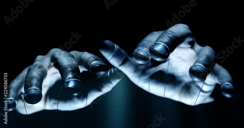 Fotografía Puppet hands from leadership controlling our lives. Concept