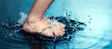 Splash Of Water In Woman Foot