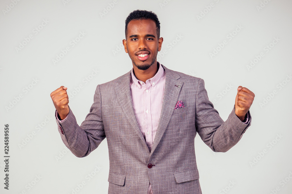 Fotomural  Winning success happy afro man businessman celebrating successful deal