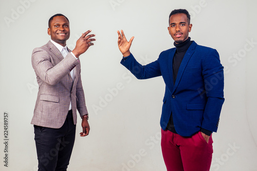 Fotografía two handsome young Afro American businessman in classic suit rejoicing and exult