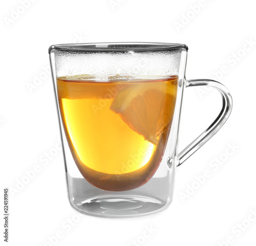 Staande foto Thee Glass cup with hot tea and lemon on white background
