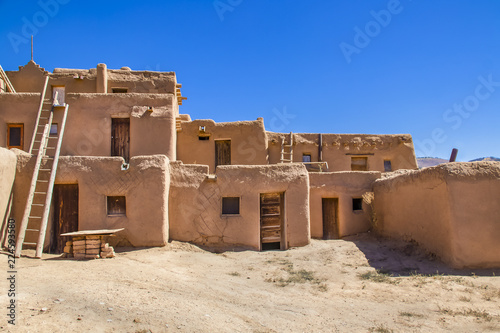 Photo Multi-story adobe buildings from Taos Pueblo in New Mexico where Indigenous peop