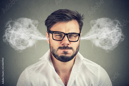 Fotografering  angry young man, blowing steam coming out of ears