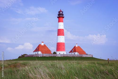 Foto op Aluminium Vuurtoren Leuchtturm an der Nordseeküste