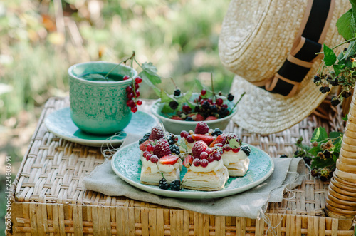 Fotografie, Obraz  Puff pastry cakes with cream filling and berry topping