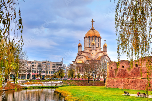 Cuadros en Lienzo Beautiful landscape in fall season with Fagaras Cathedral among the river, Roman