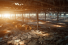 Abandoned, Haunted And Ruined Industrial Warehouse Or Factory Building Inside In Sunlight, Large Hall With Perspective, Ruins And Demolition Concept