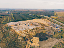 City Dump Or Big Garbage Dump With Trucks And Bulldozers, Aerial Or Top View
