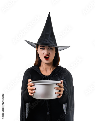 Fotografía  Portrait of woman in black Scary witch halloween costume standing with hat isola