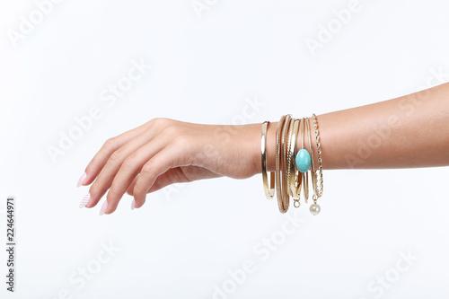 Female hand with bracelets on white background