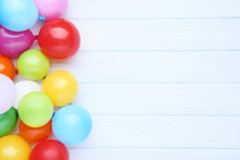 Colorful Balloons On White Wooden Table