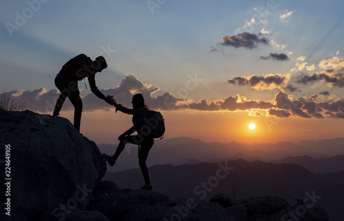 Canvas Print Help and support for men and women climbers