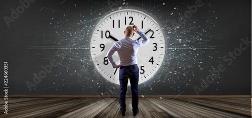 Obraz Man holding a clock timer 3d rendering - fototapety do salonu