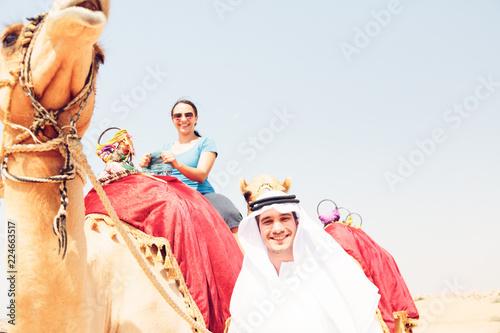 Valokuva  Arabian Man And Tourist Riding A Camel