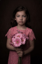 Portrait Of Girl With Bouquet Of Pink Gerberas