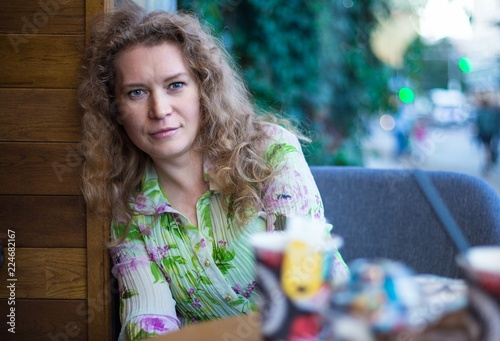 Fotografie, Obraz  Portrait of a young woman in a cafe.