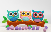 Toy Owls Handmade On A Branch. Light Background.