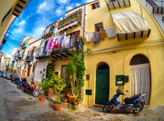 Fototapeta Traditional narrow street in the old town of Cefalu in Sicily, Italy
