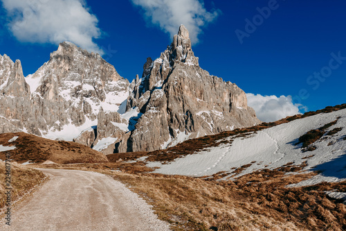 Beautiful sunny day in Italian Alps. Mountain landscape with road. Dolomites, Italian Alps