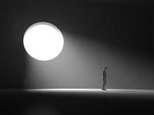 Man Stands Near A Light Window In A Dark Room