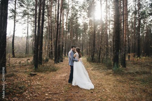 Obraz na płótnie Happy bride and groom in the forest