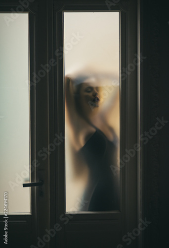 Fotografie, Obraz  Blur woman silhouette in mysterious mood. Guess my mood today