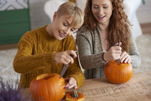 Friends Carving Pumpkins For H...