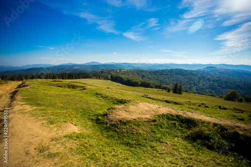 Beautiful landscape of summer mountains with blue sky. Autumn mountain village panoramic landscape